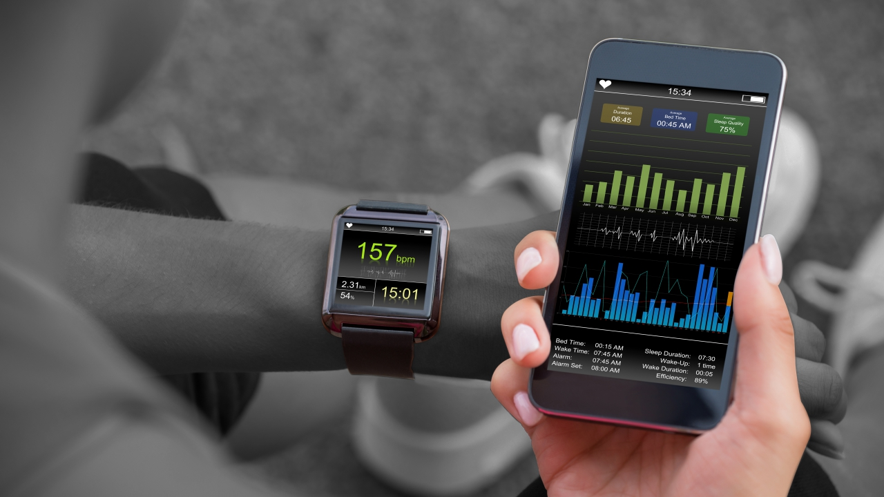Woman checking stats on her running gadgets